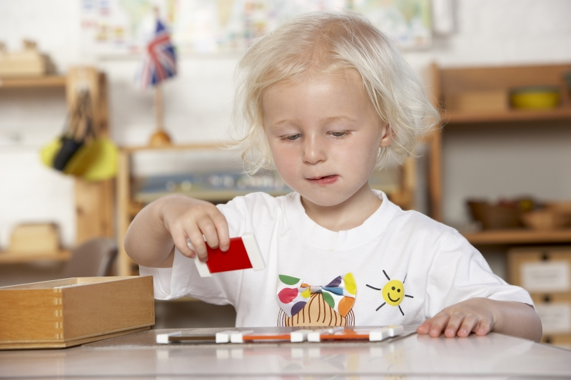 2176196-adult-helping-young-children-at-montessori-pre-school