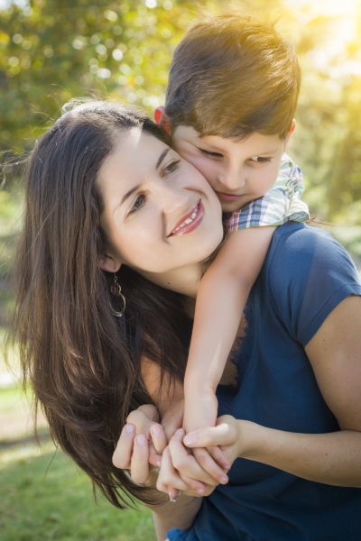 8590007-attractive-mixed-race-mother-and-son-hug-in-park